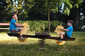 Little boys on seesaw — Foto Stock