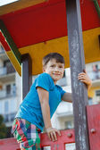 Little boy smile on top of jungle gym — Stock fotografie