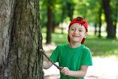 Little caucasian boy in nature — Stock Photo