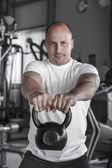 Training with kettlebell in gym — Foto Stock