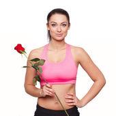 Fit frau mit rose — Stockfoto