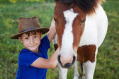 Little boy with pony — Stock Photo