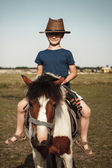 Little kid with pony — Stock Photo