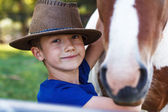 Little boy with pony closeup — Stock Photo