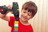 Little preschooler boy build construction — Stock Photo