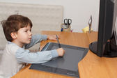 Boy draw on tablet — Stock Photo