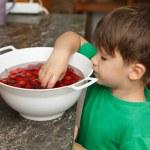 Little boy take out fresh cherry — Stock Photo #49578329