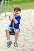 Happy little boy sit on swing rope — 图库照片