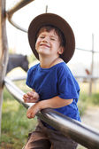 Little caucasian boy laughing on farm — Stockfoto