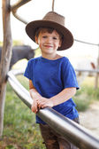 Little happy caucasian boy on farm — Stockfoto