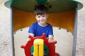 Little boy as helmsman on playground — Stock Photo