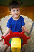 Little boy as steersman on playground — Stock Photo
