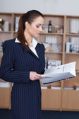 Businesswoman read catalog — Stock Photo