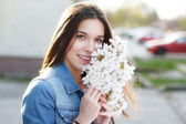 Happy woman smell cherry flower — Stock Photo