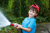 Boy pours outdoor — Stock Photo