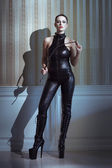 Sexy woman with whip — Stok fotoğraf