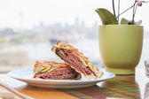 Pastrami Sandwich with a City View — Stock Photo