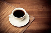 Coffee cup on table — Stock Photo