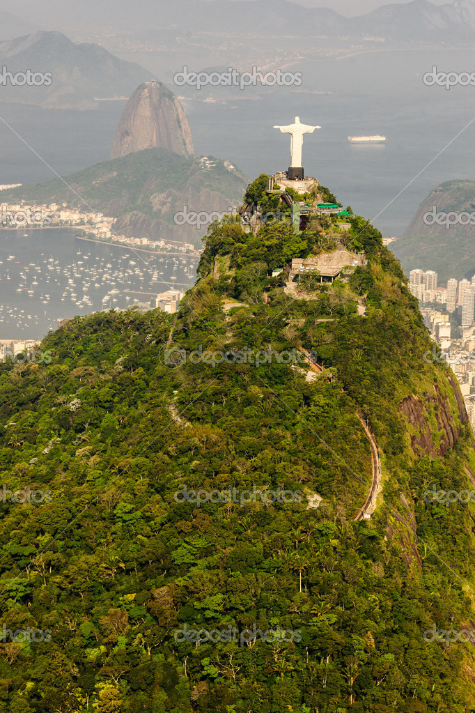 Aerial view of Rio de Janeiro taken from a helicopter. In view are the landmarks Christ the Redeemer and Sugarloaf Mountain.  Stock Photo #14588177