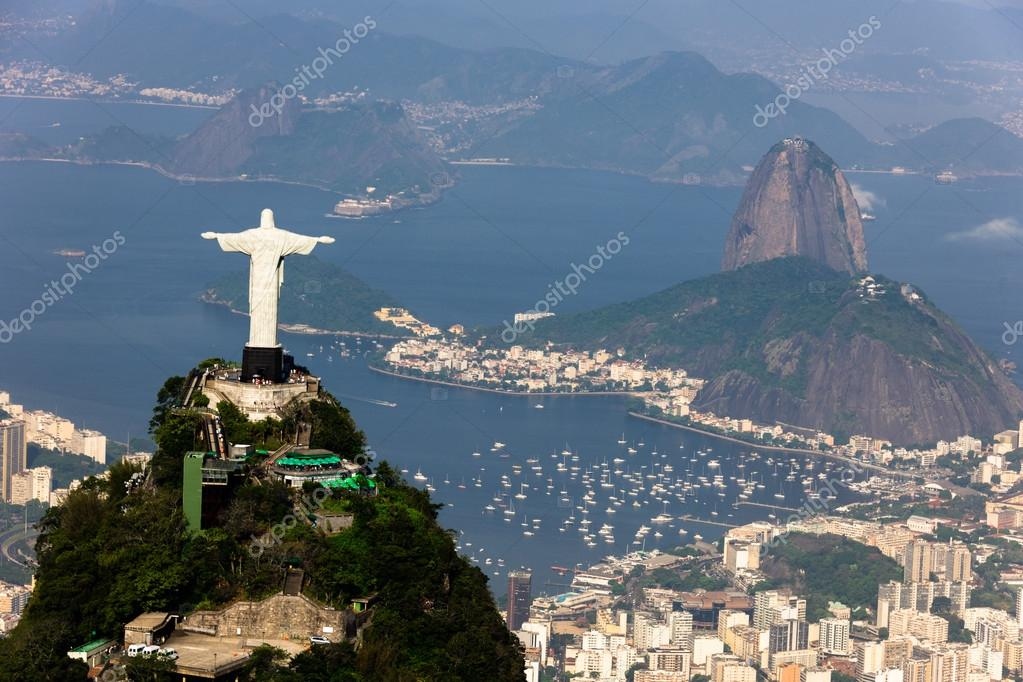 Aerial view of Rio de Janeiro taken from a helicopter. In view are the landmarks Christ the Redeemer and Sugarloaf Mountain. — Stock Photo #14588225