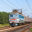 Passenger train hauled by electric locomotive — Stock Photo