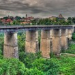 Stock Photo: Old bridge in Kamianets-Podilskyi, Ukraine. HDR image