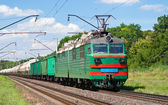 Electric locomotive pushing a cargo train — Stock Photo