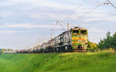 Freight train hauled by diesel locomotive. Belarusian railway — Stockfoto