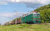 Freight train hauled by electric locomotive. Ukrainian railways — Stock Photo
