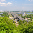 View of highway and railway bridges from a hill over the Dnieper — Stock Photo #13436472