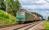Freight train hauled by old electric locomotive. Ukraine — Stock Photo