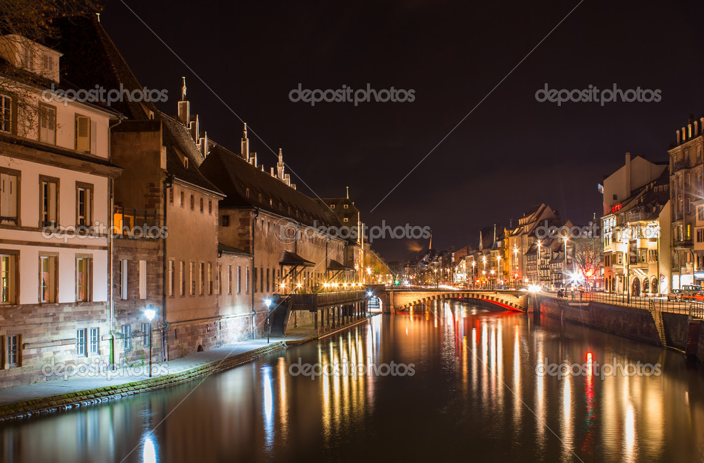 Ill river in Strasbourg - Alsace, France. Old Customs House (Ancienne douane) on the left. — Stock Photo #19591793