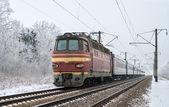 Passenger train hauled by electric locomotive — Stock Photo