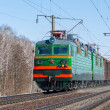 Freight train hauled by electric locomotive — ストック写真