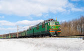Freight train hauled by electric locomotive. Ukrainian railways — Stock Photo