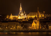 Matthias Church and Protestant church in Budapest at night — Stock Photo
