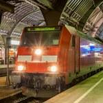 Постер, плакат: Electric lovomotive with regional express train in Karlsruhe sta