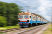 Suburban electric train on a blurred background — Stok fotoğraf