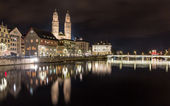 Zurich on banks of Limmat river at winter evening — Stock Photo