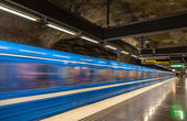 Train leaving Stadshagen metro station in Stockholm — Stock Photo