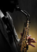 Saxophone in shadow — Stock Photo