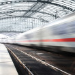 A moving train at railway station in Berlin — Stock Photo