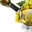 White wine glass, white grapes and bottle on the table — Stock Photo #32505305