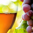 Wine collection: Closeup of rose wine glass and grapes in vineyard — Stock Photo #32506057