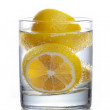 Fresh collection: Sliced lemon in glass of water — Stock Photo #33011815