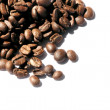 Roasted coffee beans on white background — Stock Photo