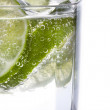 Stock Photo: Detail of sliced lime in glass of water