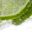 Stock Photo: Slice of lime in water