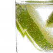 Stock Photo: Closeup view of glass with sliced lime in water