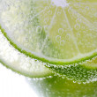 Stock Photo: Macro view of sliced lime in water